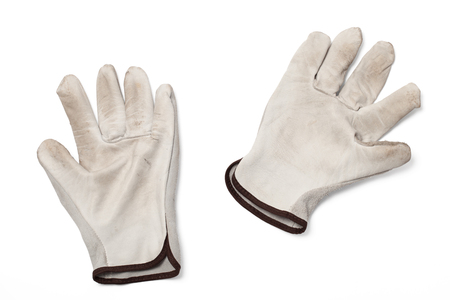 Dirty leather work gloves isolated on white background. photo