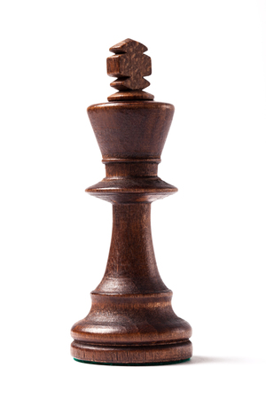 Black king, chess figure isolated on white background. photo