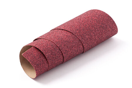 coarse: Roll of coarse sandpaper isolated on white. Stock Photo