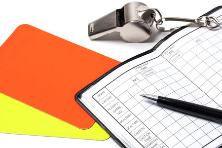 Referee cards, whistle, notebook and pen, isolated on white background photo