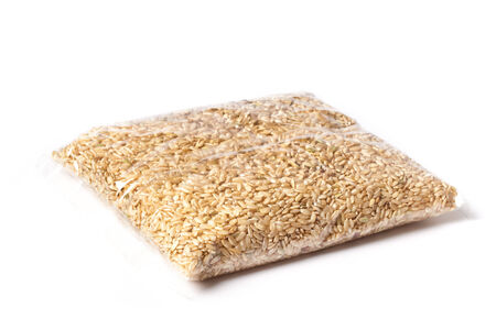 kilo: One kilo brown rice in a package. Stock Photo