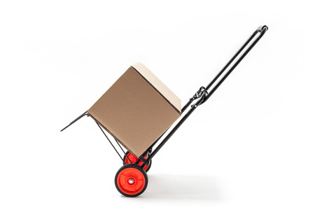 Hand truck - cart with carton box isolated on white. photo