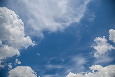 cirrus: White cirrus and cumulus clouds on a sunny blue sky. Stock Photo