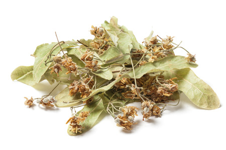 linden blossom: Dried linden flower  Isolated on white background. The flowers resemble miniature umbrellas with yellowish color, have a strong flavor and are used for making tea. Linden blossom has a disinfectant, anti-inflammatory and diuretic.