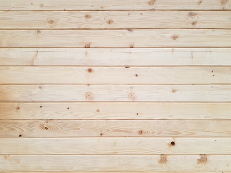 Treated natural wooden pine boards arranged horizontally side by side as texture background