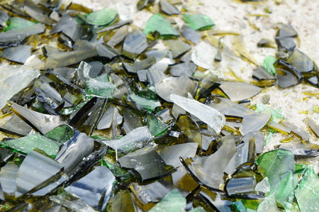 solid background: Fragments of colored broken glass on a concrete surface Stock Photo