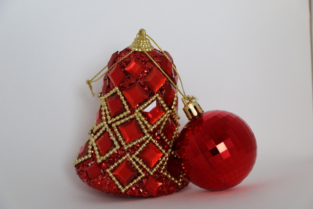 Bright red Christmas toys with sparkles, rhinestones and golden beads