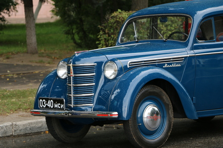historical events: YOSHKAR-OLA, RUSSIA, AUGUST 5, 2017: Exhibition of old cars on the square - Rare Soviet car of the Muscovite of the USSR era in blue Editorial