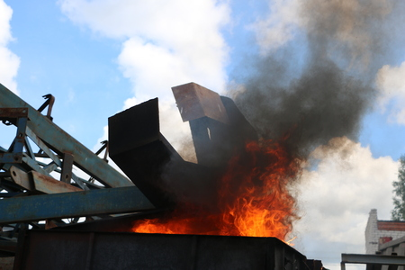 Iron metal structures covered with a bright flame of fire from containers