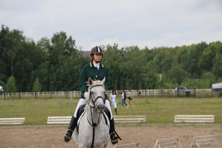 Medvedev, RUSSIA, AUGUST 26, 2017: Open championship on horse racing and jumping devoted to the day of the settlement of Medvedev - show-jumping- jumping over an obstacle