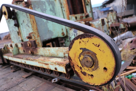 old abandoned rusty machine tool in non-working condition, half disassembled