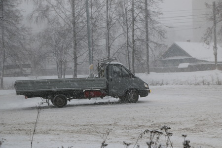 YOSHKAR-OLA, RUSSIA - DECEMBER 03, 2017: Training in guided drifts on snow, ice and snowdrifts into snowfall - drift on the cargo on-board machine- on an empty car park in the city Editorial