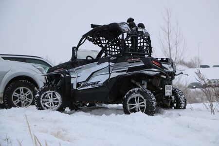 KAZAN, RUSSIA - DECEMBER 23, 2017: Opening of the Winter Season in Kazan Ring Canyon - Free open auto show - presentation and off-road racing - snow-covered forest track - on off-road cars and ATVs Editorial