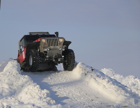 SALTAC-KOREM, RUSSIA - FEBRUARY 11, 2018: Winter auto show of jeeps - Ice kneading 2018. Jumping from je eps - Offroad