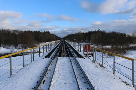 railway in winter. Rails and sleepers -  road for locomotives and electric locomotive covered with snow.