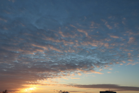dawn over  city.  sky with fluffy clouds at dawn. sunrise over houses. Stock fotó