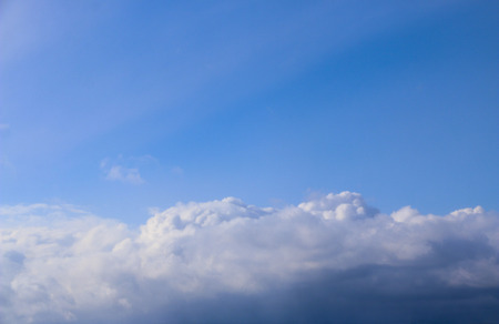 Spring. blue sky with fluffy white clouds. sun, sunlight through  clouds,  sky - spring changeable weather.