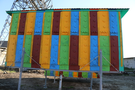 large multi-colored mobile apiary for 48 hives. wooden house for several families of bees.