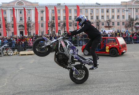 YOSHKAR-OLA, RUSSIA - MAY 5, 2018: Motoshow in central square of  city. Tricks on motorcycle, stuntmen, Stunt Riding - Wheelie, Stoppie and Akrobatyka on motorcycle.