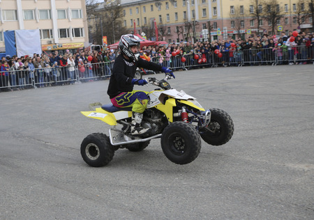 YOSHKAR-OLA, RUSSIA - MAY 5, 2018: Auto-Moto-show in central square of  city. Tricks on ATV stuntmen, Stunt Riding - Wheelie, Stoppie and extreme acrobatics on quad bike. Editorial