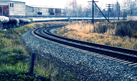 railway in the industrial zone. empty rails with  semaphore, in anticipation of  freight train.