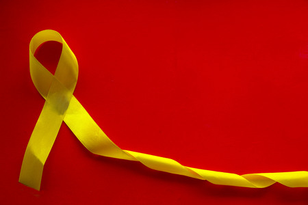 World cancer day. Bright colored ribbon-a symbol of the fight against cancer and hope for recovery from cancer. International Agency for research on cancer