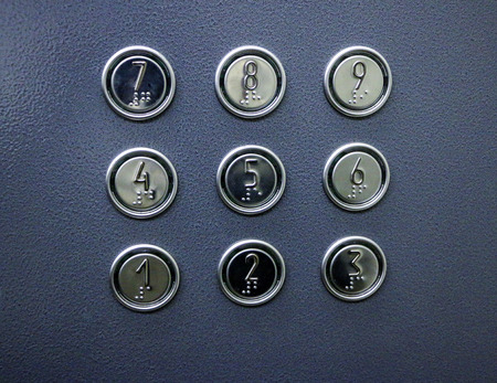 elevator buttons with numbers and symbols for the visually impaired and blind. Stockfoto