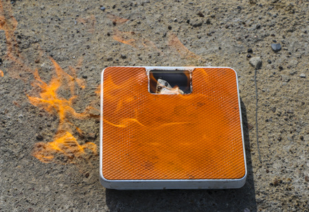Burning floor scales on asphalt textural background. concept - burning calories, slimming and burning weight with the help of diets and sports exercises.