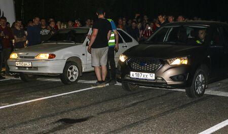 YOSHKAR-OLA, RUSSIA, MAY 12, 2019: illegal night races on drag racing on an empty highway