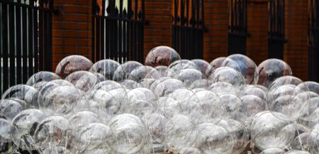 round big transparent inflatable balls with diode ribbon, for holidays and celebrations. Imagens