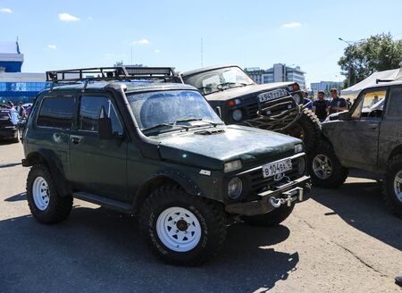 YOSHKAR-OLA, RUSSIA, JUNE 02, 2019: Auto and Motorcycle Exhibition - Festival - YO SUMMIT 2019 - Auto Show - the dirtiest modified SUV Niva Éditoriale