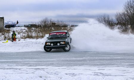 YOSHKAR-OLA, RUSSIA, JANUARY 11, 2020: Winter car show for the Christmas holidays for all comers - single and double drift, racing on a frozen lake. 에디토리얼