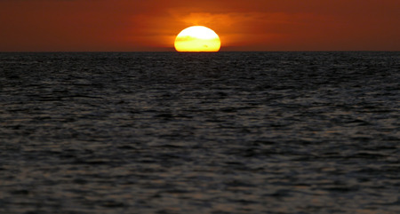equator: Incredibly beautiful sunset at Caribbean near the Equator at the azure ocean