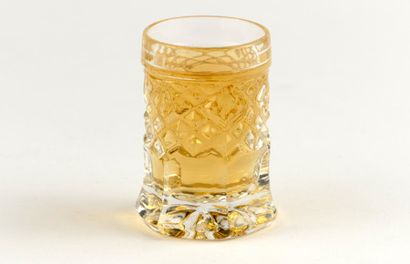 alcoholic drink: Alcoholic drink served in a glass isolated on white background