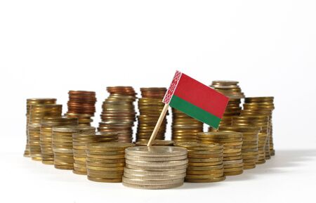 Belarus flag waving with stack of money coins Stock Photo