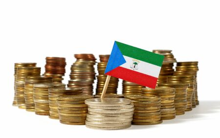 Equatorial Guinea flag waving with stack of money coins Stock Photo