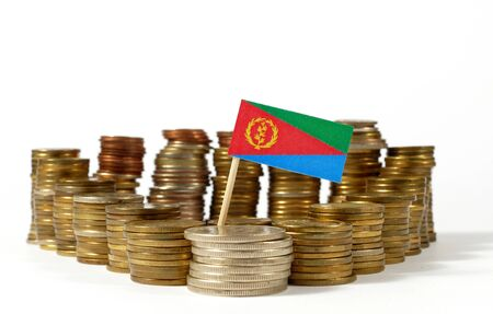 international banking: Eritrea flag waving with stack of money coins