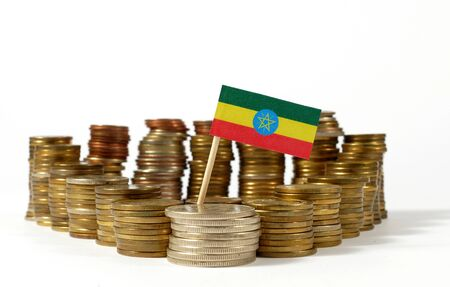 national flag ethiopia: Ethiopia flag waving with stack of money coins