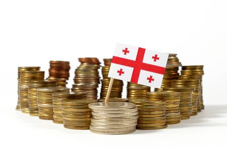 Georgia flag waving with stack of money coins Stock Photo