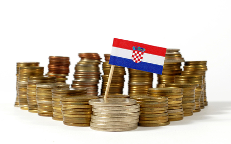 Croatia flag waving with stack of money coins