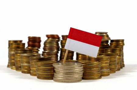 Indonesia flag waving with stack of money coins