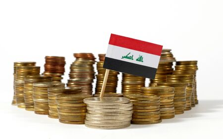 Iraq flag waving with stack of money coins Stock Photo