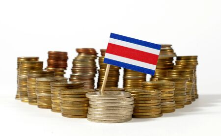 Costa Rica flag waving with stack of money coins Stock Photo