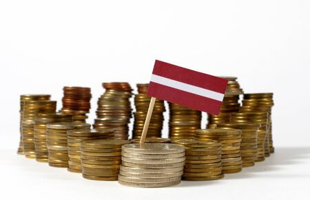 Latvia flag waving with stack of money coins