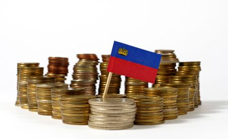Liechtenstein flag waving with stack of money coins