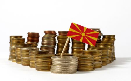 Macedonia flag waving with stack of money coins