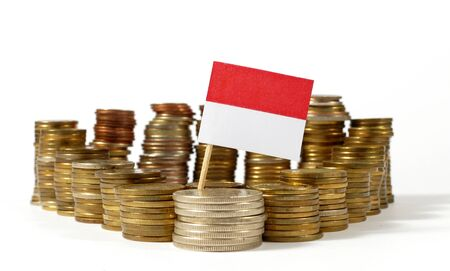 Monaco flag waving with stack of money coins