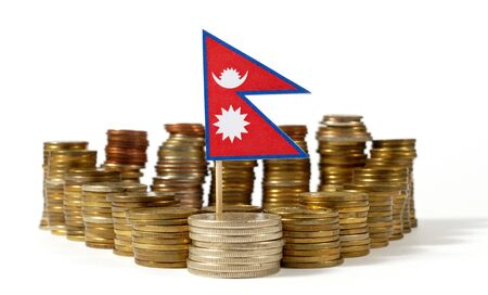 Nepal flag waving with stack of money coins Stock Photo