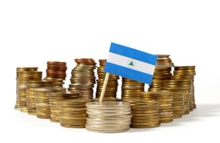 Nicaragua flag waving with stack of money coins