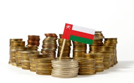 oman background: Oman flag waving with stack of money coins Stock Photo
